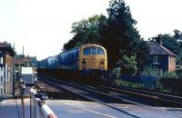 A westbound train headed by one of the Southern Region Class 74 electro-diesel locomotives approaching Brockenhurst station over the level crossing in July 1971.<br> <br><br>[John McIntyre&nbsp;19/07/1971]