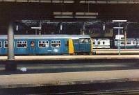 Looking over the east end bays at Newcastle Central on 25 July 1981. Class 101 DMUs in 3 different liveries flank Brush Type 2 31171 at the head of a summer Saturday train for Filey.<br><br>[Colin Alexander&nbsp;25/07/1981]