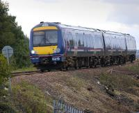 Recent vegetation clearance has opened up the lineside south of Inverkeithing as 170 457 runs downhill from Jamestown Viaduct on a Fife Circle service, on 18 September... with a cheery wave from the driver!<br><br>[Bill Roberton&nbsp;18/09/2008]