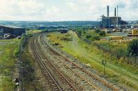 Looking towards Fouldubs Junction from the east end of Grangemouth West Yard in 1989. This was taken from the now removed footbridge. From left to right: lifted yard, line to oil terminal, line to docks, lifted lines to station and docks.<br><br>[Ewan Crawford&nbsp;//1989]
