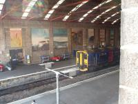 The trainshed at Penzance is an impressive structure but quite gloomy inside, which means that the murals on the walls are not always seen to best effect. 150233 waits to return to Plymouth on a FGW stopping service in September 2008.<br><br>[Mark Bartlett&nbsp;18/09/2008]