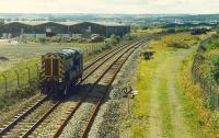 An 08 makes its way back to Fouldubs Junction from the Grangemouth oil terminal in 1989. The buffers on the right are the east end of Grangemouth West Yard. View from now removed footbridge.<br><br>[Ewan Crawford&nbsp;//1989]