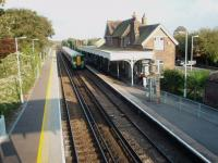 Bosham sees 377422 call on an evening, westbound south coast service. View from the footbridge, which is adjacent to a level crossing, towards Chichester. <br><br>[Mark Bartlett&nbsp;13/09/2008]