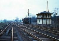 View south from Beattock station during a quiet period in the 1960s. One of the bankers is using the opportunity to take on water in the siding alongside Beattock South box.<br><br>[Robin Barbour collection (Courtesy Bruce McCartney)&nbsp;//]