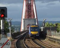 Sunshine from the south as this Aberdeen to Edinburgh service leaves the towering structure of the Forth Bridge at Dalmeny<br><br>[Brian Forbes&nbsp;/09/2008]