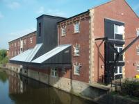 Not a railway building but who could resist this former canal warehouse. It is now Lomeshaye <I>(Lommashaw)</I> Medical Centre in Nelson and what a fantastic conversion. The consulting rooms are under the awning overlooking the water and many original features have been incoroprated such as the crane seen at the side. Once upon a time it would have been flattened and replaced with a concrete box. <br><br>[Mark Bartlett&nbsp;26/09/2008]