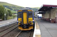 156467 stands with the 1440 to Glasgow Central at Girvan on 4 August.<br><br>[Bill Roberton&nbsp;04/08/2008]