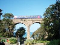 Almost perfectly framed, 153361 crosses the viaduct overlooking the stunning Carbis Bay before caling at the station on another run from St Ives down to the mainline junction at St Erth. <br><br>[Mark Bartlett&nbsp;18/09/2008]
