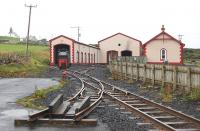 The Bushmill and Giants Causeway Railway has been relaid on the easternmost end of a tramway closed in 1949, using equipment from the Shanes Castle Railway.  On my visit the loco in use was <i>Shane</i>, formerly Bord na Mona No.3,<br> built by Andrew Barclay of Kilmarnock in 1949. View of the terminus with carriage and loco shed. 5 August 2008.<br><br>[Bill Roberton&nbsp;05/08/2008]
