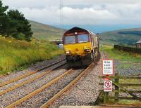Now would not be a good time to cross between platforms. Northbound freight approaches the pedestrian LC at Dent.<br><br>[Ewan Crawford 02/09/2008]