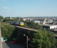 The low viaduct immediately east of Nelson station sees Northern Rail Pacer 142040 crossing on its way to the terminus at Colne against the backdrop of the town.<br><br>[Mark Bartlett&nbsp;26/09/2008]