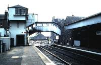 The unique signal box and footbridge arrangement at Broughty Ferry. Photographed in August 1985 looking over the level crossing towards Aberdeen.<br><br>[David Panton&nbsp;22/08/1985]