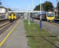 A Northern Rail service from Blackpool North to Liverpool Lime Street has just arrived at Platform 2 at Leyland on 23 September alongside a TransPennine Express service from Manchester Airport to Blackpool North at Platform 3.<br><br>[John McIntyre&nbsp;23/09/2008]