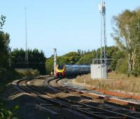 A pair of Voyagers emerging from under the wires of the WCML at Euxton Junction on 28 September and joining the route to Manchester via Chorley and Bolton. The service would normally have continued south down the WCML but was diverted via Manchester and Crewe due to engineering works. Euxton Junction had been singled some years ago but in 2006 double track running onto the Chorley line was restored.<br><br>[John McIntyre&nbsp;28/09/2008]