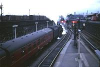 A BR Standard class 5 takes a Glasgow train out of Dundee c late 50s/early 60s. The former NB and Caledonian goods yards are on the left and right respectively, Dundee West signalbox can be seen through the smoke in the centre of the picture and the coaling plant at 62B stands on the horizon.<br><br>[Robin Barbour Collection (Courtesy Bruce McCartney)&nbsp;//]