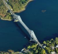 Aerial view of the Connel bridge on 5 October 2008. The bridge was built by Arrols Bridge & Roof Co [see image 18249] to carry the Ballachulish branch of the Callander & Oban Railway over Loch Etive and opened on 20 August 1903. A roadway was added alongside the line in 1914. The Ballachulish branch closed in 1966 and today the bridge carries single file road traffic controlled by traffic lights.<br><br>[Brian Smith&nbsp;05/10/2008]