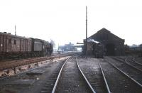 Scene at Beattock in the 1960s. A banker simmers outside the shed between duties as a Britannia Pacific heads south towards the station with a freight. <br><br>[Robin Barbour collection (Courtesy Bruce McCartney)&nbsp;//]
