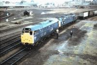 31273 in the process of removing an ailing class 40 from a southbound freight at York in the Summer of 1984. The south end of York station can be seen in the background.<br><br>[Colin Alexander&nbsp;//1984]