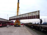 Sections of the former Merry Street bridge in the process of being transferred from road to rail at Mossend Euroterminal in preparation for their journey north to the Strathspey Railway on 3 October.<br><br>[Mick Golightly&nbsp;03/10/2008]