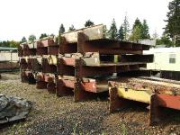 Like parts of a giant Meccano set, the numbered sections of bridge decking are stored at Boat of Garten until needed for spanning the River Dulnain. [With kind permission of the Strathspey Railway.]<br><br>[John Gray&nbsp;10/10/2008]