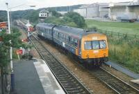 Unit 101 692 on the crossover from the reversing siding at Cumbernauld in July 1997 about to form the next service to Motherwell. The unit is in experimental ScotRail red, blue an gold livery. <br><br>[David Panton&nbsp;12/Ju/1997]