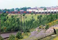 An 08 shunts Ravenscraig No. 3 in 1988 before heading north over the Merry Street bridge. The buffer stop at the bottom right is the reversing spur used to reach the huge scrap yards between Ravenscraig and Dalzell works also used to deliver Concast slabs to DL.<br><br>[Ewan Crawford&nbsp;//1988]