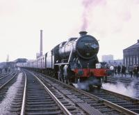 The Manchester Rail Travel Society / Severn Valley Railway Society <i>North West Tour</i> of 20th April 1968, hauled by Stanier 8F 48773, photographed during a stop at Broadfield station (closed 1970) between Bury and Rochdale. The chimney of the Unity Mill, Heywood, stands in the background.<br><br>[Robin Barbour Collection (Courtesy Bruce McCartney)&nbsp;20/04/1968]