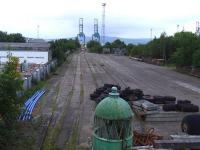Looking over the site of Princes Pier Shed, it was latterly is use as container sidings for Greenock Ocean Terminal. To the left is Greenock Central Sawmills, where the shed buildings stood. The sidings have been out of use for some years. <br><br>[Graham Morgan&nbsp;20/09/2008]