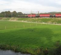 A two-tone green class 47 on the rear of southbound ecs move on the WCML just south of Garstang & Catterall on 12 October 2008. The water in the foreground is the Lancaster Canal.<br><br>[John McIntyre&nbsp;12/10/2008]