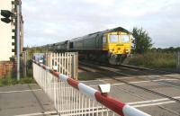 Having left the northbound ECML at Northallerton, Freightliner 66952 takes coal empties over the level crossing at Picton on 3 October, heading for Teesside. <br><br>[John Furnevel&nbsp;03/10/2008]
