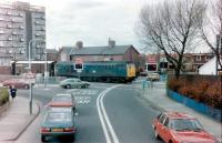 The ungated level crossing at Fawdon with a class 31 on the Rowntrees goods in 1983.  In those days BR freight shared the then Bank Foot branch of the Tyne & Wear Metro, since extended to Newcastle Airport.<br><br>[Colin Alexander&nbsp;//1983]