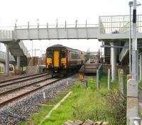 A Glasgow Central - Carlisle service pulls away from Gretna Green on 27 September with work on the extended station nearing completion.<br><br>[John Furnevel&nbsp;27/09/2008]