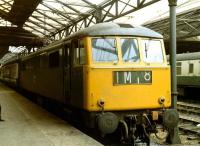 E3146 on a southbound service recently arrived from Glasgow stands at the south end of Crewe station on 10 June 1971.<br> <br> <br><br>[John McIntyre&nbsp;10/06/1971]