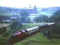 Ivatt Ex-LMS Class 2 2-6-2T 41241 takes a train across Mytholmes viaduct, spanning the River Worth on the KWVR in the 1960s. The train is just about to enter the short tunnel on the climb towards Haworth.<br><br>[Robin Barbour Collection (Courtesy Bruce McCartney)&nbsp;//]