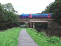 Although the Lancaster Canal runs near to the WCML for much of its length this bridge just south of Lancaster Castle station is the only point where the active section of the canal crosses the railway. A northbound Trans Pennine 185 unit drops down the bank towards its stop at Lancaster on 10 September. (Map Ref SD 474609)<br><br>[Mark Bartlett&nbsp;10/09/2008]