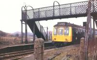 The short branch line to Royton closed in 1966 but Royton Junction station on the <I>Oldham Loop</I> remained open. It was well away from anywhere though and, after nearby Derker opened in 1985, it was allowed to close in 1987. A Derby DMU is seen here heading for Oldham with the Royton branch formation visible beyond the Rochdale platform. Although the line remains open all trace of Royton Junction (and of the branch terminus) has gone.<br><br>[Mark Bartlett&nbsp;/02/1972]
