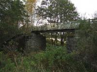 The four miles of trackbed between Grantown-on-Spey East and Nethy Bridge have been made into a walkway. This single file wooden bridge replaces the original structure about one and a half miles south of Grantown. View south with the River Spey in the background.<br><br>[John Gray&nbsp;22/10/2008]
