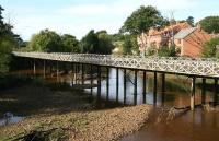 The bridge bringing the Whitby branch into Ruswarp, looking west along the River Esk on 2 October 2008.<br><br>[John Furnevel&nbsp;02/10/2008]