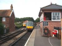 A former Marylebone Class 115 DMU waits by the signal box at Bishops Lydeard for a WSR evening departure to Minehead. The 4-car set is in excellent condition and behind, in the short siding, is preserved BRCW Type 3 D6566/33048. <br><br>[Mark Bartlett 14/09/2008]