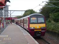 The westbound platform at Bellgrove station on 15 September 2007 with 320 304 boarding a service for Balloch.<br><br>[David Panton&nbsp;15/09/2007]