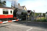Ex-SR class S15 4-6-0 No 825 about to cross the Esk at Ruswarp on 2 October with a through Pickering - Whitby service. The bridge once carried a double track railway as well as a now deckless foot crossing (nearest the camera).<br><br>[John Furnevel&nbsp;02/10/2008]