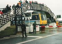 <I>NO, NO!!! ...A SEVEN IRON, A SEVEN IRON....!!!</I> The driver of a <i>Golfers Special</i> DMU is temporarily distracted prior to leaving the platform at Carnoustie for the siding during <I>The Open Golf Championship</I> on 17 July 1999. <br><br>[David Panton&nbsp;17/07/1999]