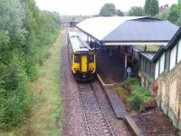 156461 is Manchester bound at Atherton viewed from the road overbridge.  The staircase leading to the booking office can also be seen in this view as can the formation of the second line but the old platform is covered by trees. At the time of our visit the overall roof on the island platform was being painted underneath. <br><br>[John McIntyre&nbsp;30/09/2008]