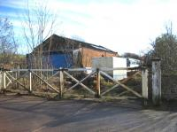 The level crossing gates and goods shed at Appleby East in February 2007. The station is to the right of the picture (towards Warcop). Passenger services were withdrawn in 1962 but freight remained between Appleby and Hartley Quarry until 1974 when it was cut back to Warcop serving the Army camp and training area until 1989. Appleby East yard and station is now the site of a local recycling company although the present Eden Valley Railway hopes to reopen the line from its base at Warcop to Appleby East.<br><br>[John McIntyre&nbsp;18/02/2007]