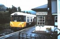 In the mid 1980s a few of the BRCW built class 104 DMUs were sent to Scotland, with one unit being repainted in a unique maroon & white livery and used on the Oban line. This unit became known as <I>The Mexican Bean</I> and is seen here at Crianlarich having arrived on a service from Oban in September 1985.<br><br>[David Panton&nbsp;14/09/1985]