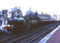 Scene at Lanark on 16 October 1965 with ex-Great North of Scotland Railway 4-4-0 No 49 <I>Gordon Highlander</I> at the head of a Branch Line Society railtour. The old church behind the locomotive has since been demolished and replaced by a modern office block. <br><br>[Robin Barbour Collection (Courtesy Bruce McCartney)&nbsp;16/10/1965]