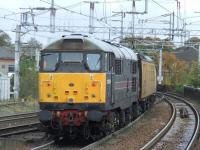 31106 <I>Spalding Town</I> at the rear of overhead line test coach <I>Mentor</I> as it crosses Wallneuk Junction after passing through Paisley Gilmour Street<br><br>[Graham Morgan&nbsp;22/10/2008]