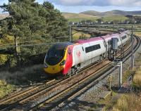 A southbound Pendolino approaching Crawford on 28 October 2008. The newly positioned signal alongside the down line has done nothing for what used to be a favourite photo location. <br><br>[Bill Roberton&nbsp;28/10/2008]