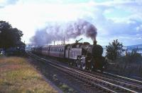 Fairburn tank 42197 passes Langbank in 1965 with a Gourock to Glasgow Central express.<br><br>[G W Robin&nbsp;26/08/1965]