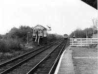 A Cravens DMU heads away from Rainford Junction on the single line section to the Merseyrail interchange at Kirkby. The DMU is just about at the point where the direct line from Ormskirk to St. Helens passed over this line. The curving platform seen here was used by passenger trains to Ormskirk until 1951 and a mirror platform on the other side catered for St. Helens services until the same year. Rainford Junction is largely unchanged today and the signalman still emerges from the box to hand over or collect the staff from trains on the single line stub. [See image 27639] <br><br>[Mark Bartlett&nbsp;03/11/1980]